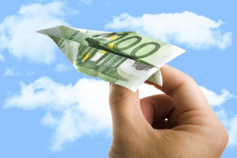 Hand Holding Banknote Paper Plane in making money and financial